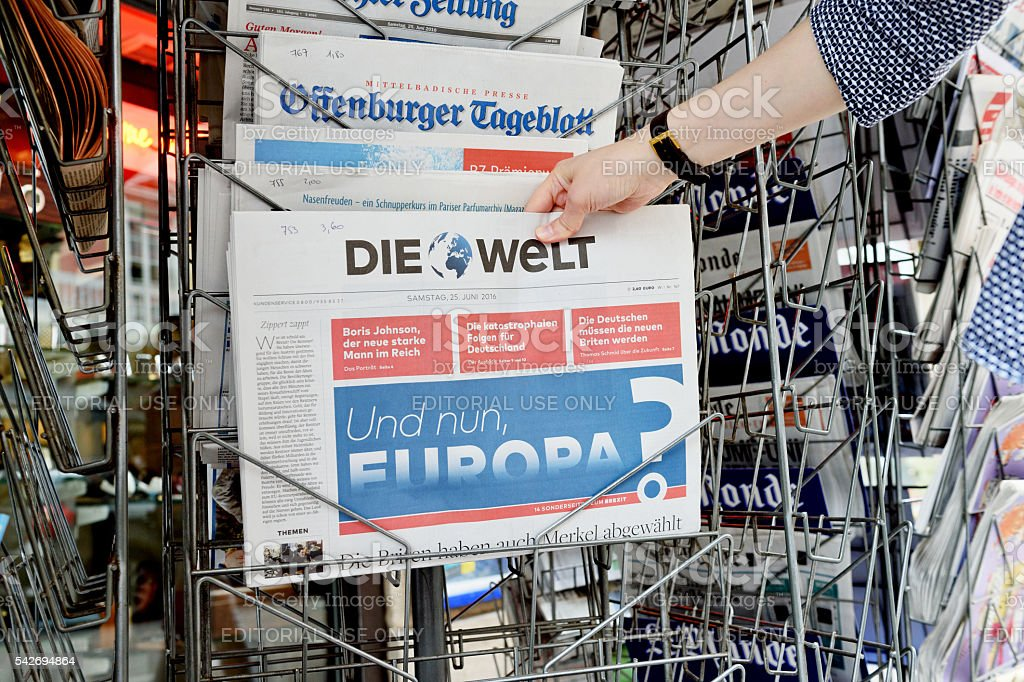 Woman buying Die Welt newspaper about Brexit stock photo