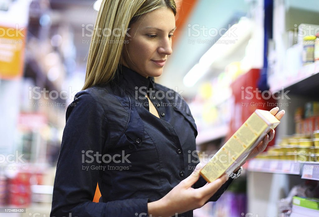 Woman buying food in supermarket. royalty-free stock photo