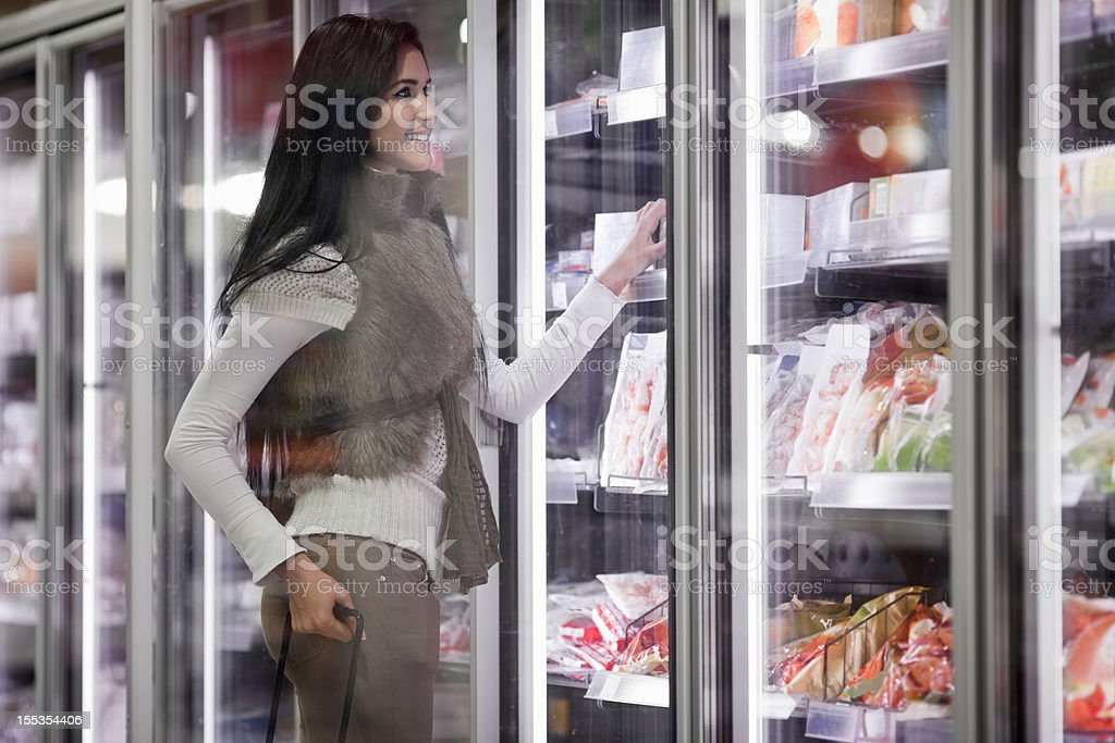 woman buying frozen food in supermarket royalty-free stock photo