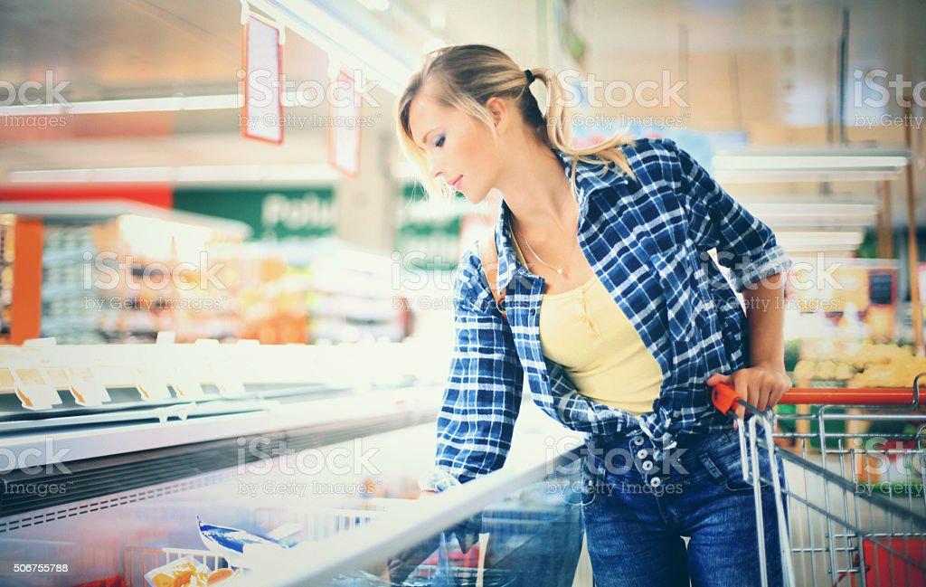 Woman buying frozen food. stock photo