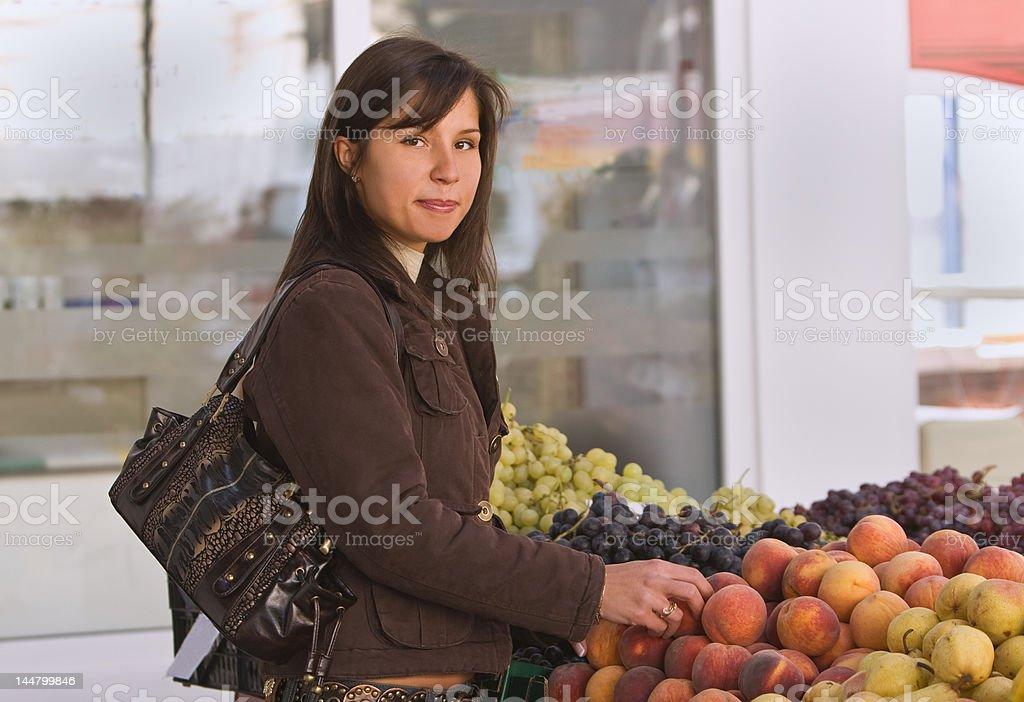 Woman buying fruits royalty-free stock photo