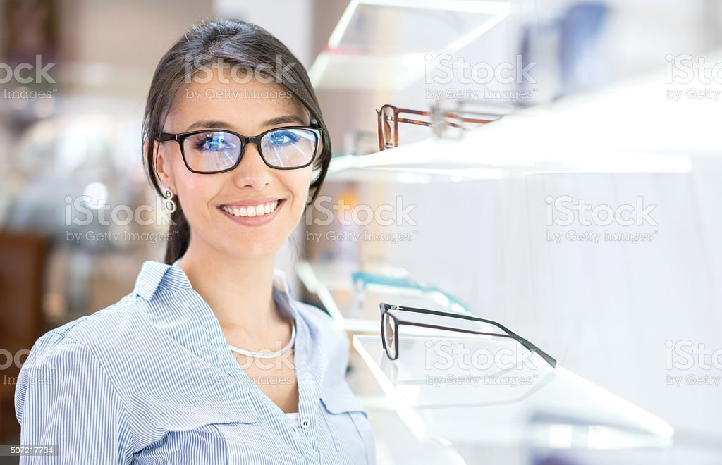 Woman buying glasses at the optician's shop stock photo