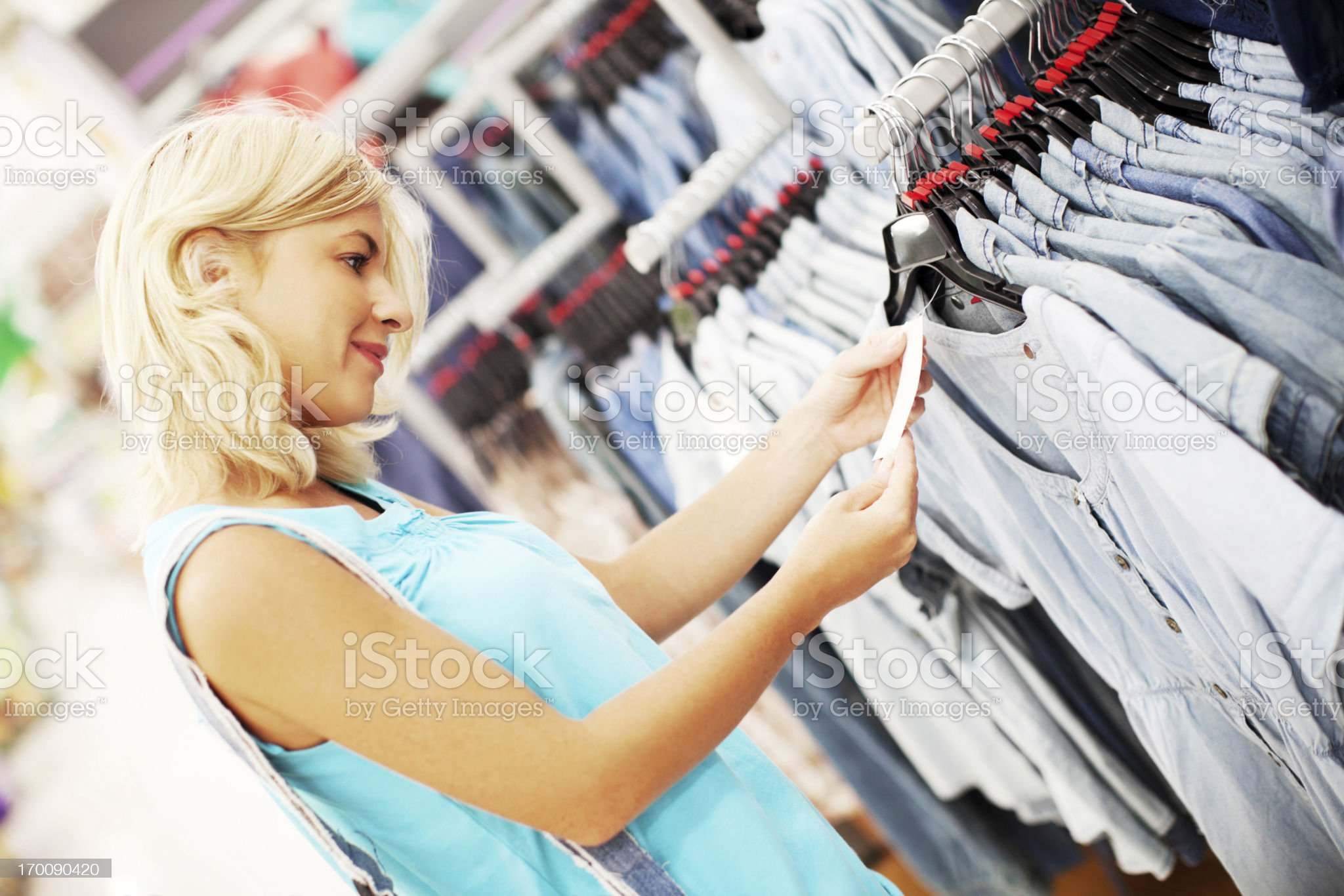 Woman buying gray t-shirt. royalty-free stock photo