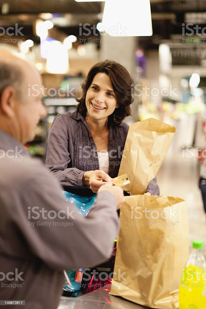 Woman buying groceries with credit card stock photo