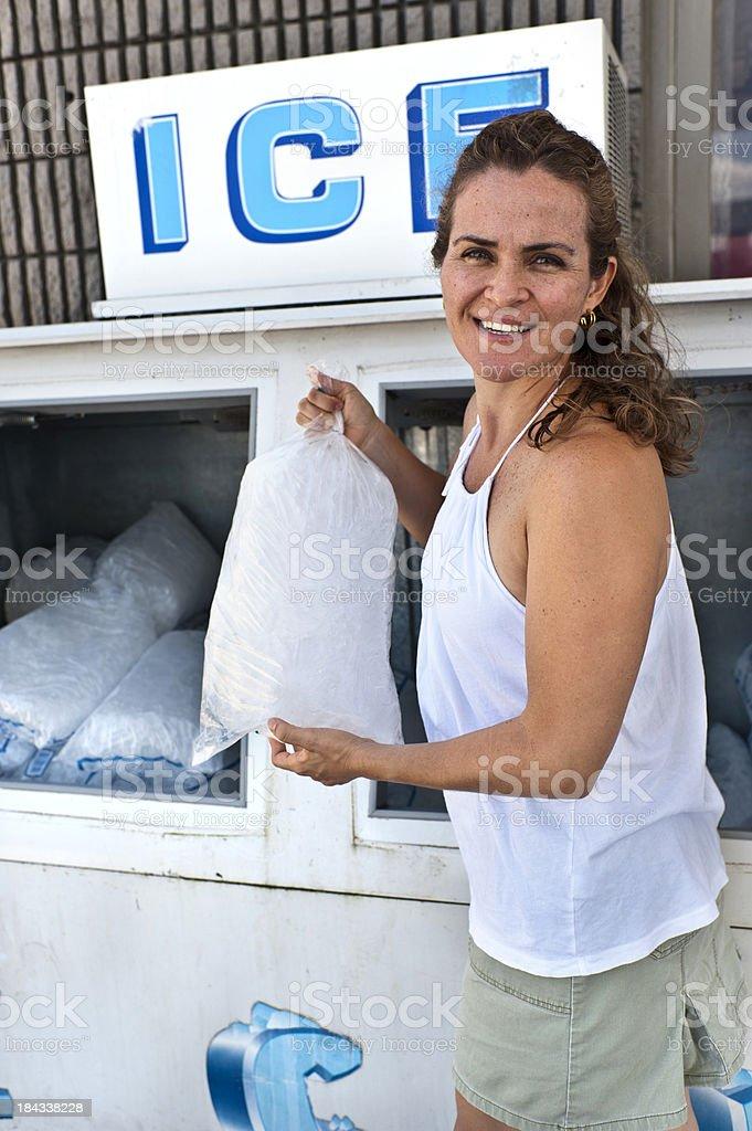 Woman Buying Ice stock photo