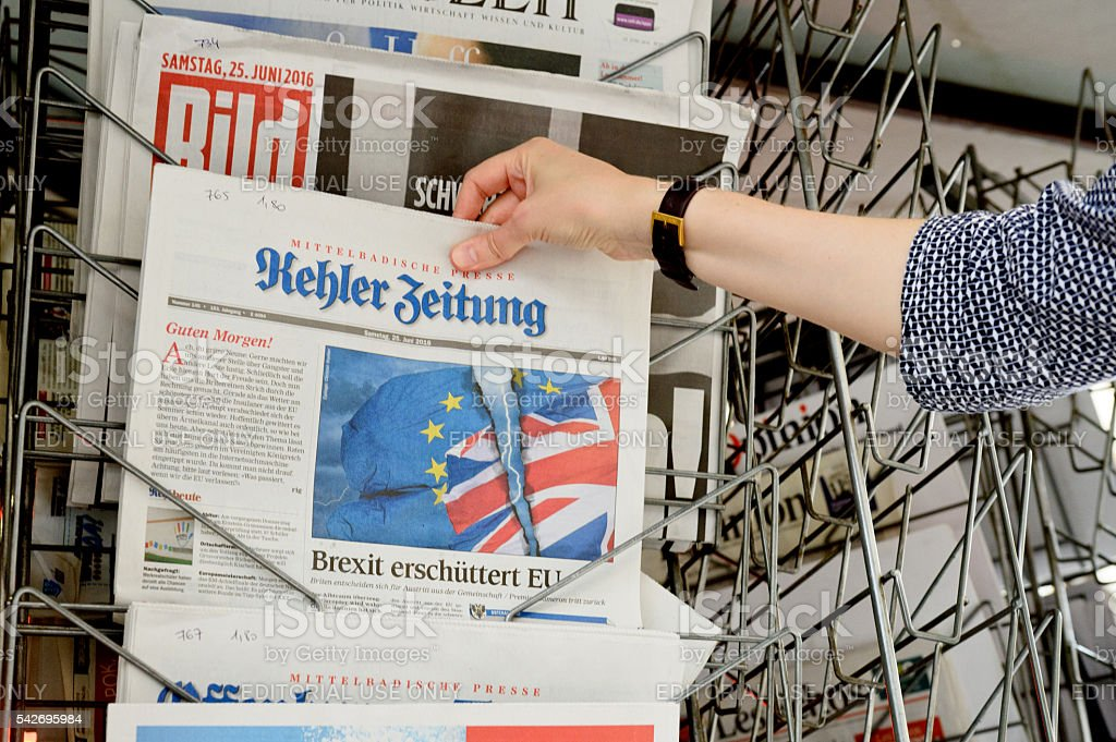 Woman buying Kehler Zeitung newspaper about Brexit stock photo