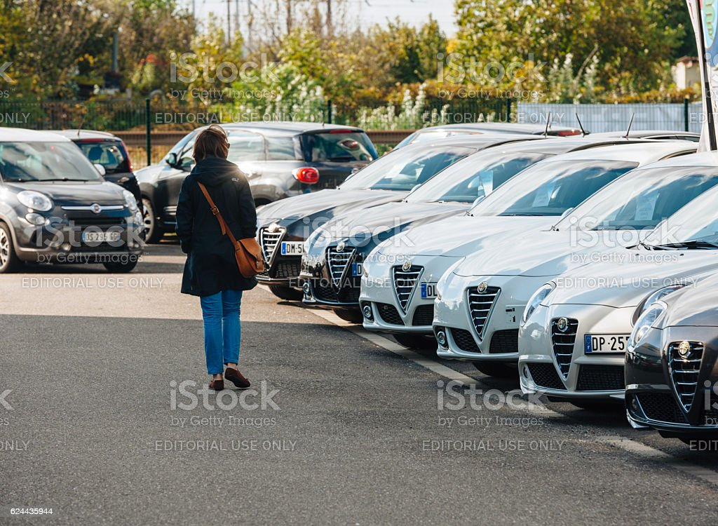Woman buying new car at shopping cars outdoor store stock photo