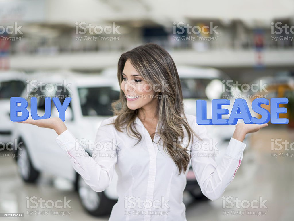 Woman buying or leasing a car stock photo