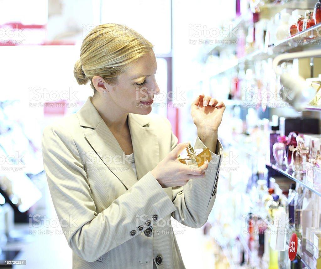 Woman buying perfume. royalty-free stock photo
