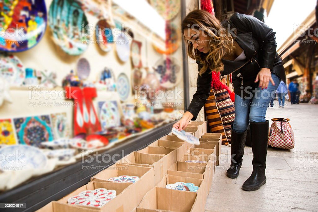 Woman Buying Pottery stock photo