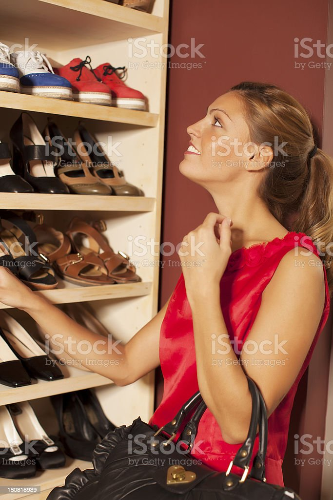 Woman Buying Shoes royalty-free stock photo