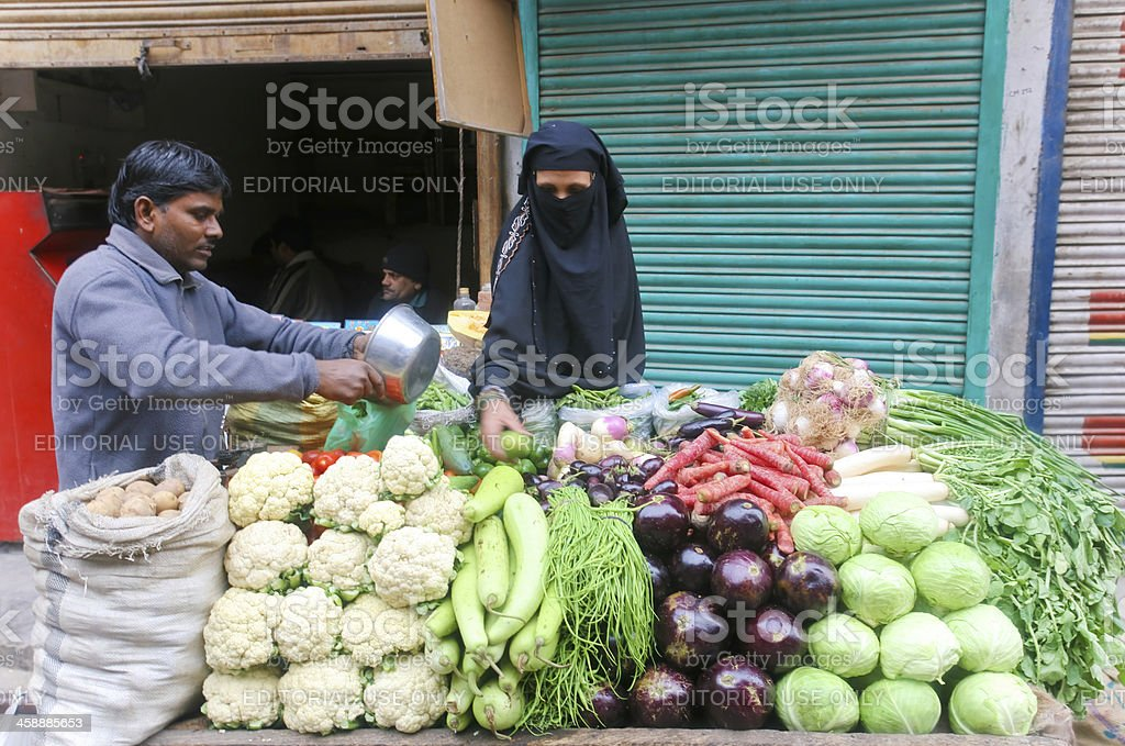 Woman buying vegetables royalty-free stock photo