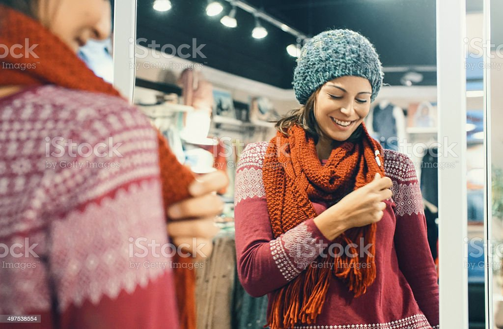 Woman buying winter clothes. stock photo