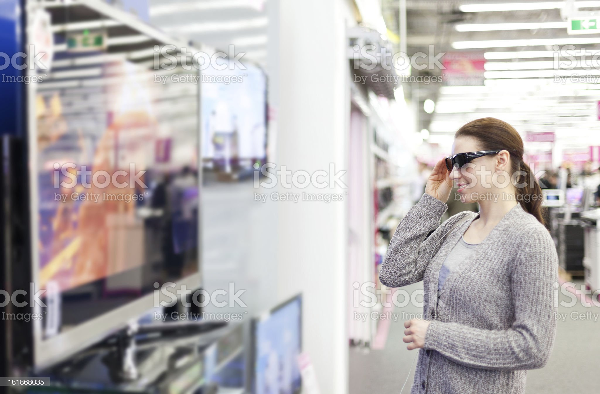 woman buys a 3D TV royalty-free stock photo