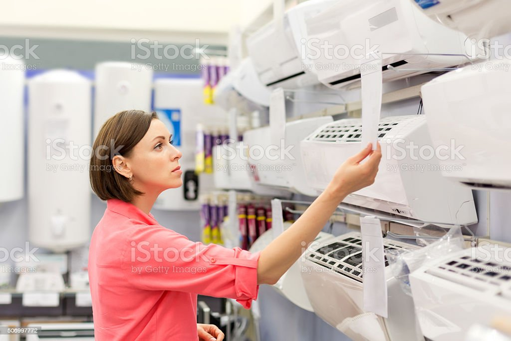 woman buys a air conditioner stock photo