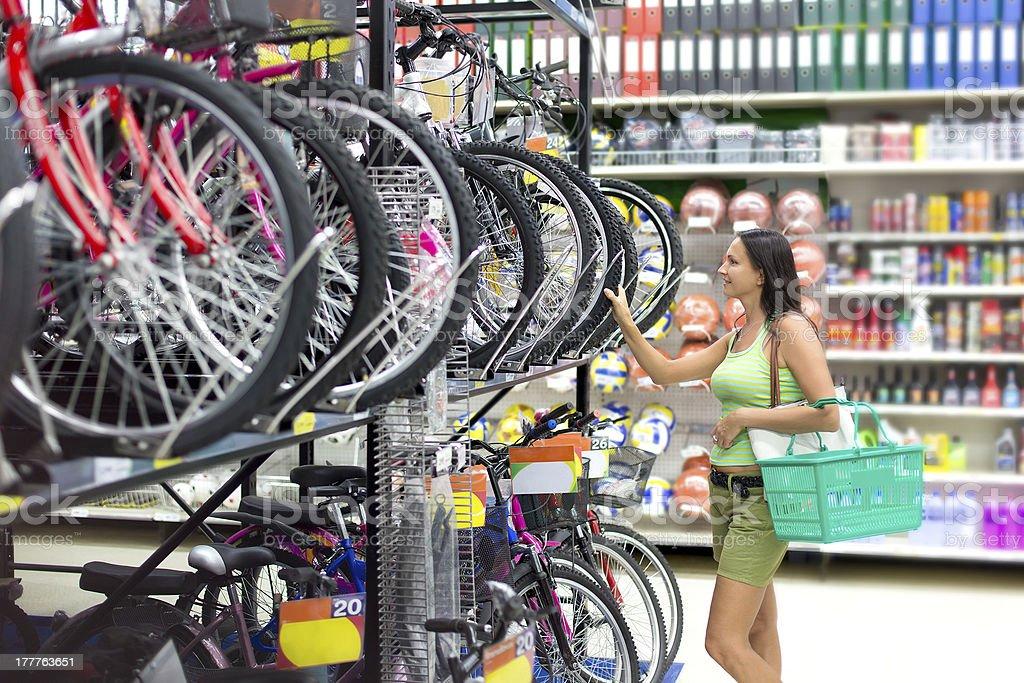 woman buys a bike shop stock photo