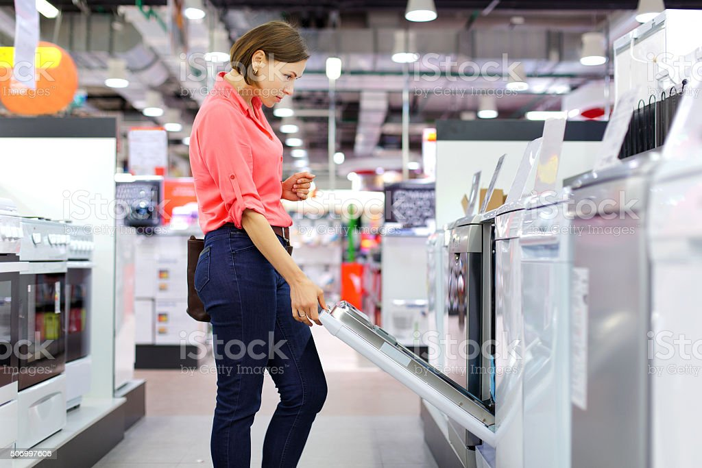 woman buys a Dishwasher stock photo