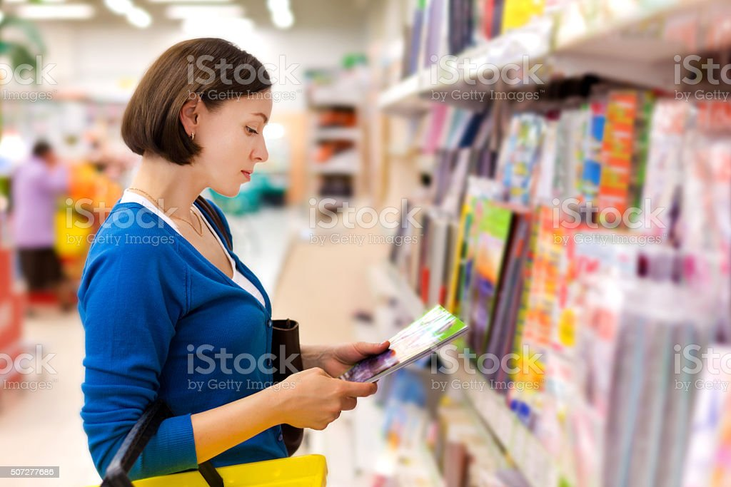 woman buys a magazine stock photo