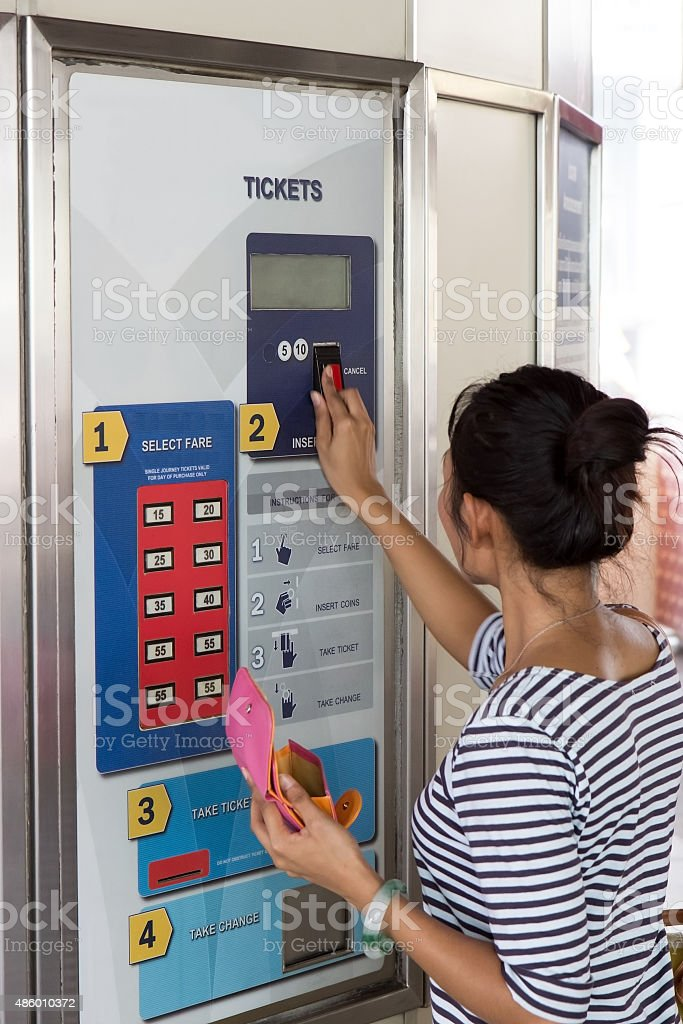 Woman buys a ticket stock photo