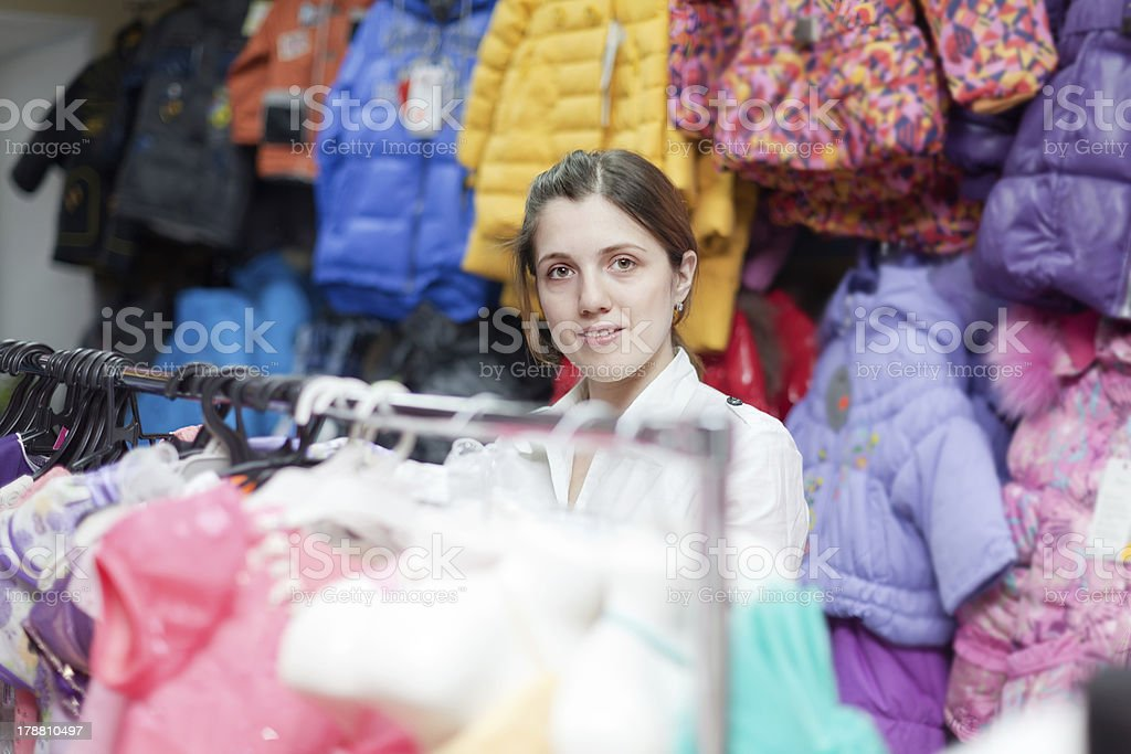 woman buys clothes for little daughter royalty-free stock photo