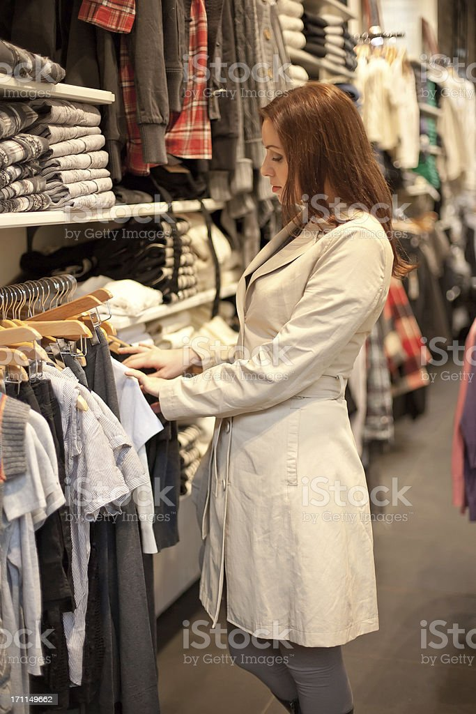 woman buys in shop. royalty-free stock photo