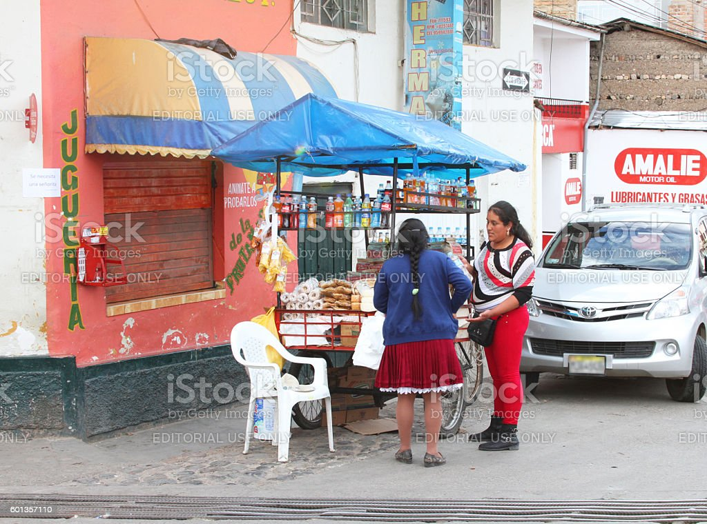 Woman Buys Snacks From Food Cart stock photo
