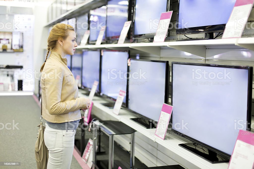woman buys the TV. royalty-free stock photo