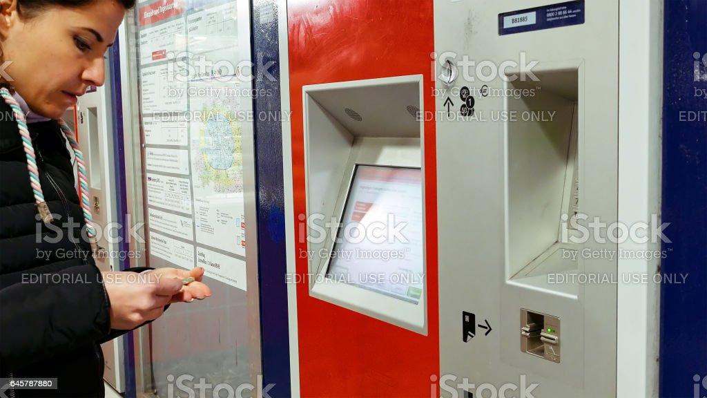 Woman buys tickets at subway station stock photo