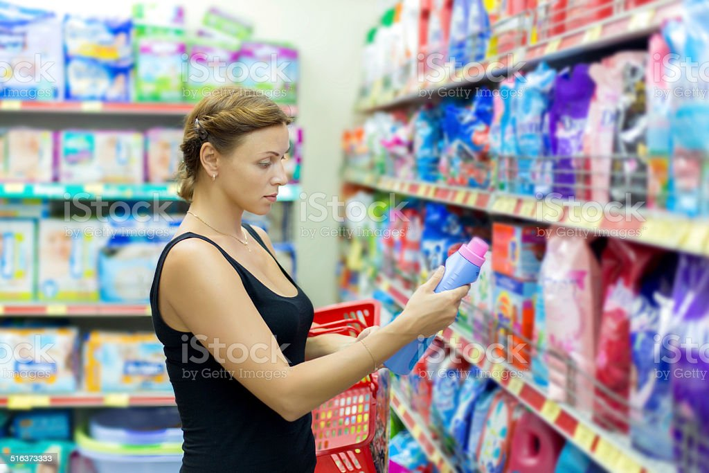 Woman buys washing powder stock photo