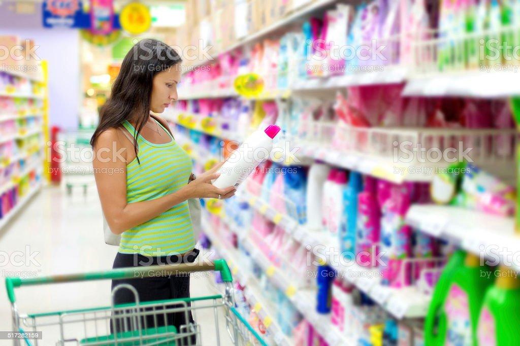 Woman buys washing powder stock photo