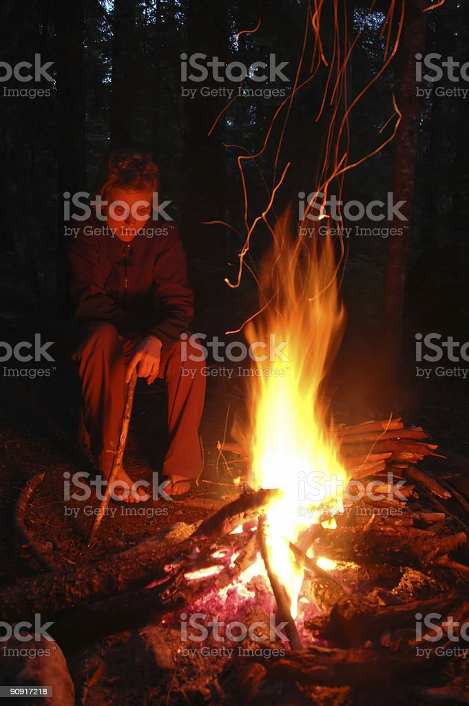 Woman by campfire royalty-free stock photo
