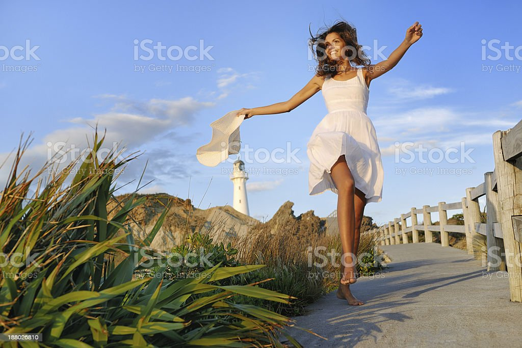 Woman by the Lighthouse, New Zealand stock photo
