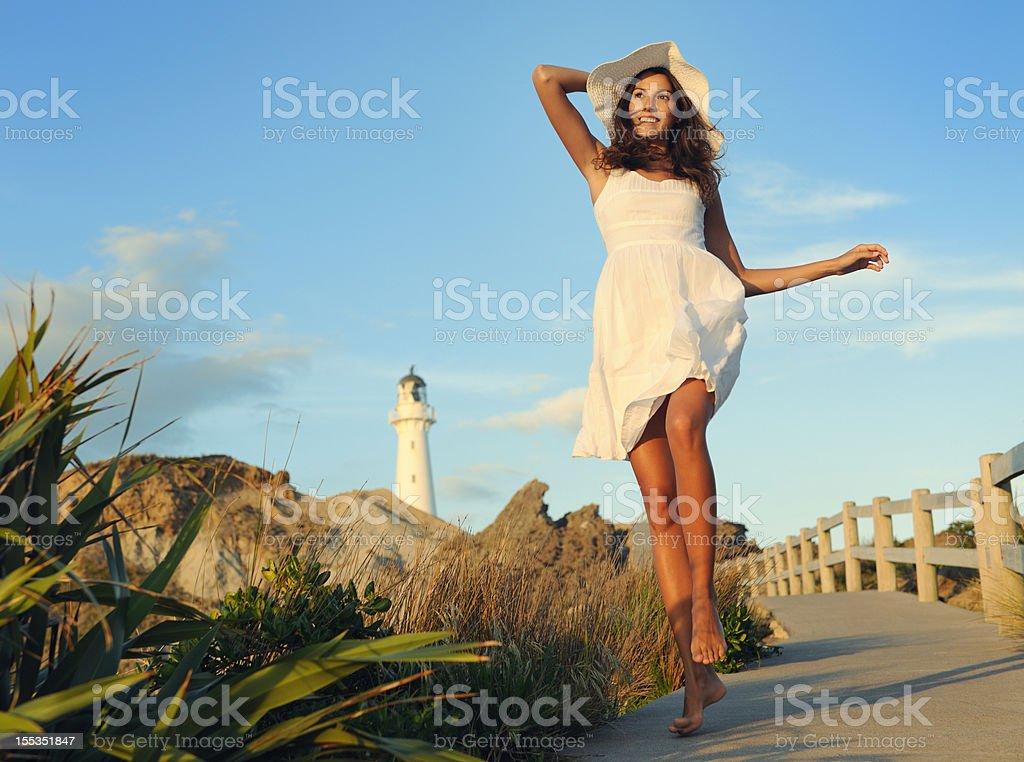 Woman by the Lighthouse (XXXL) stock photo