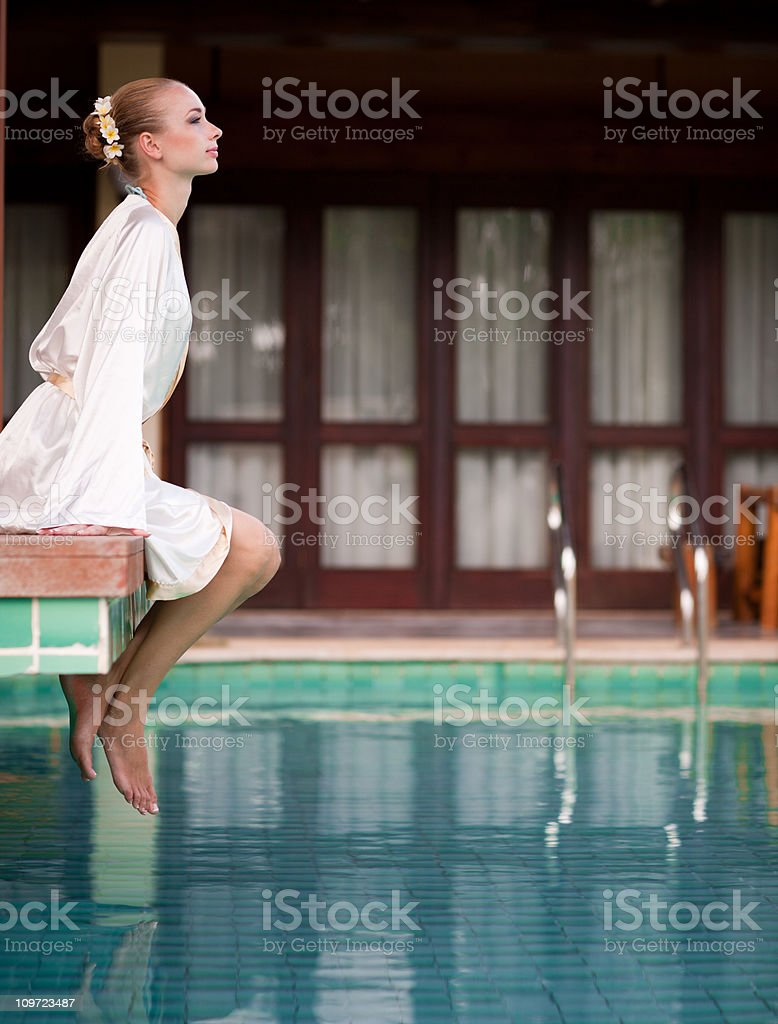 Woman by the pool royalty-free stock photo
