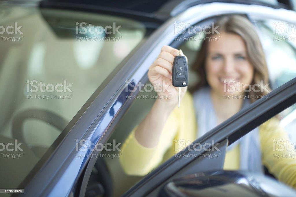 Woman bying car. royalty-free stock photo