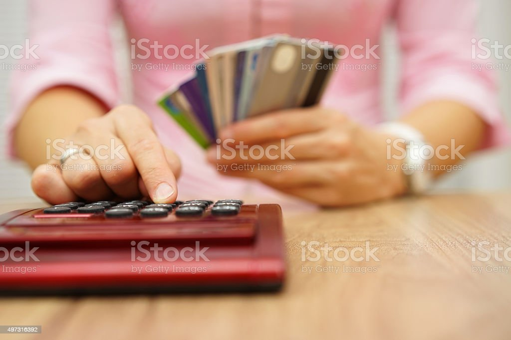 woman calculate how much cost orspending have with credit cards stock photo