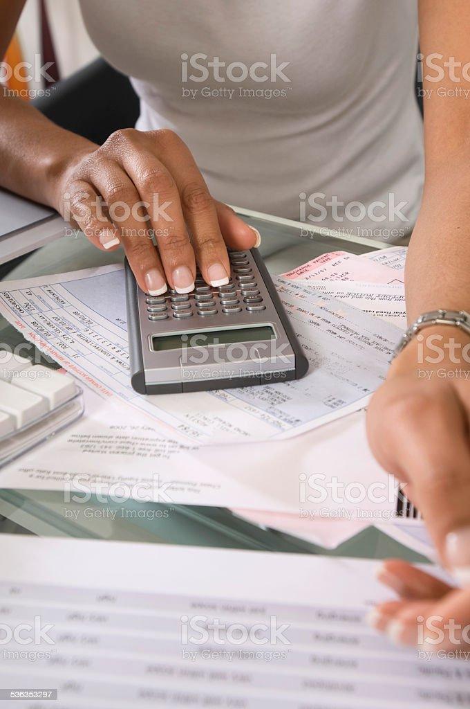 Woman Calculating Bills stock photo