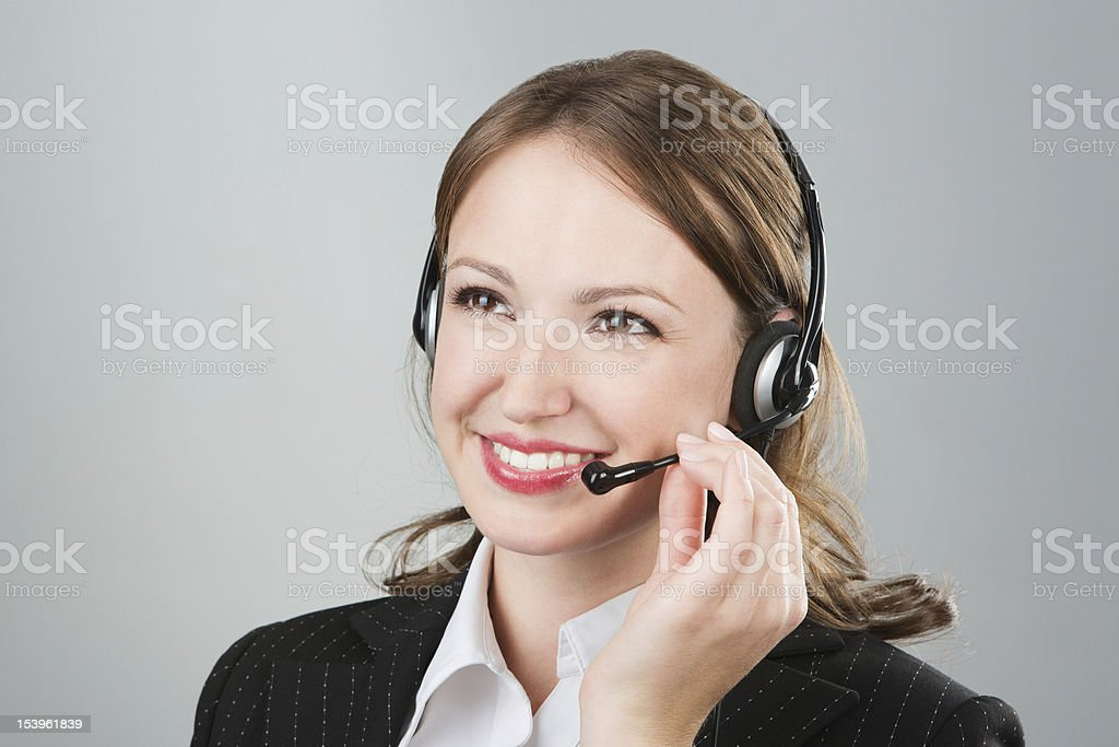 Woman call center employee speaking over the headset. royalty-free stock photo