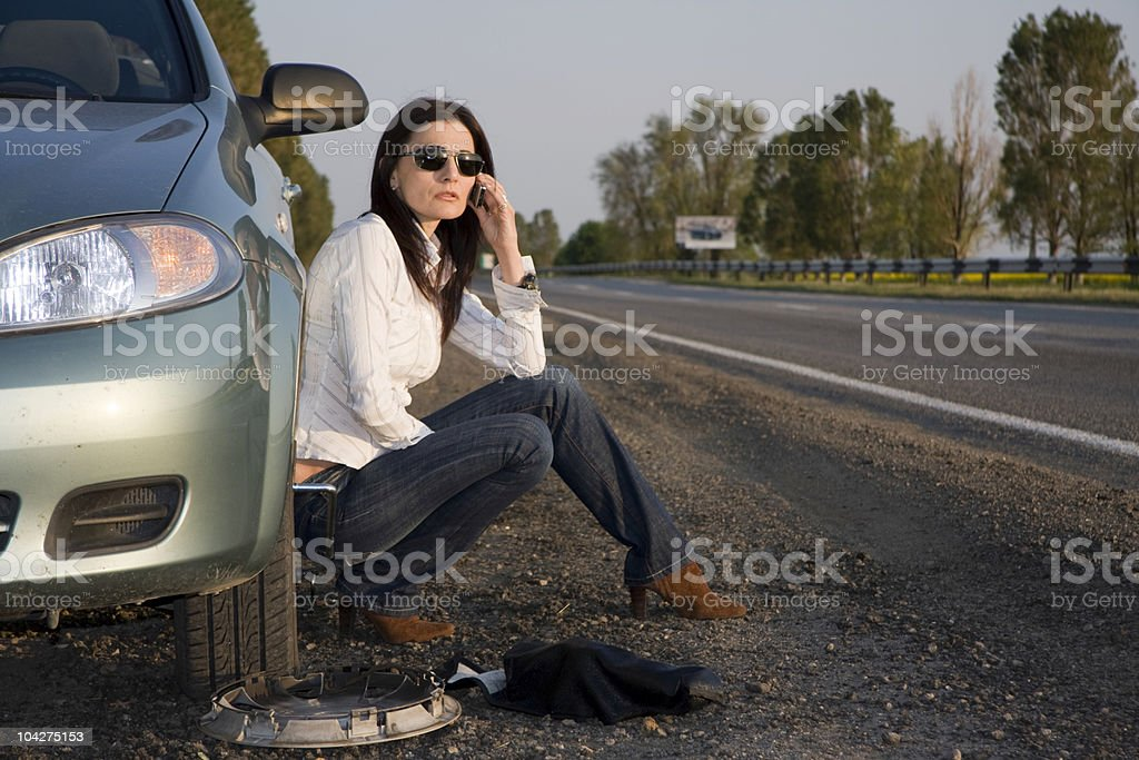 Woman calling for help from the road royalty-free stock photo