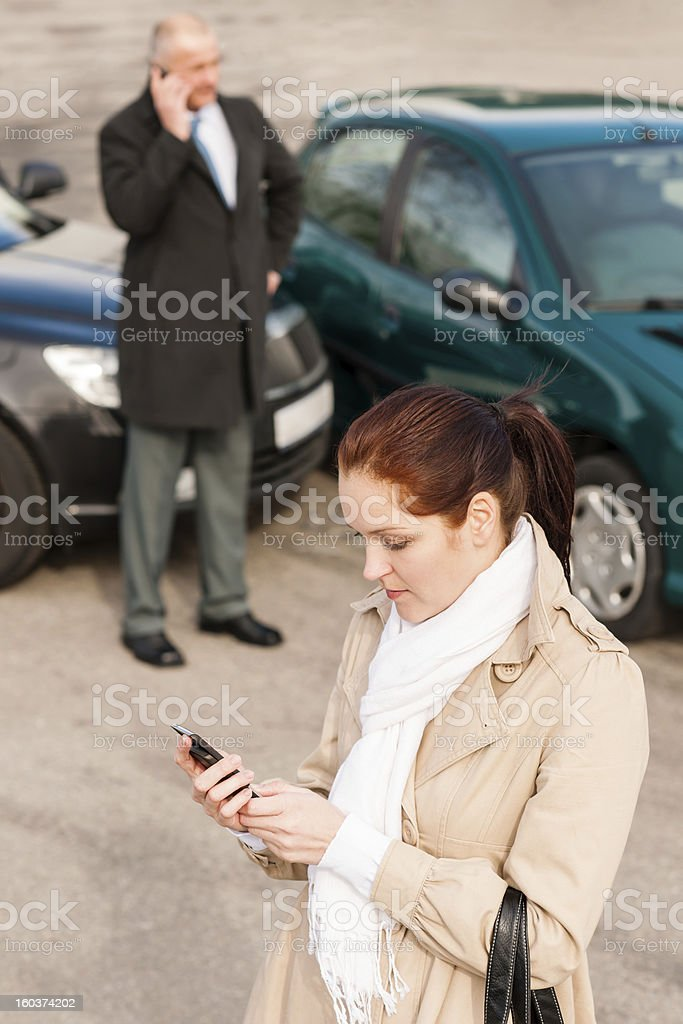 Woman calling insurance after car accident crash royalty-free stock photo