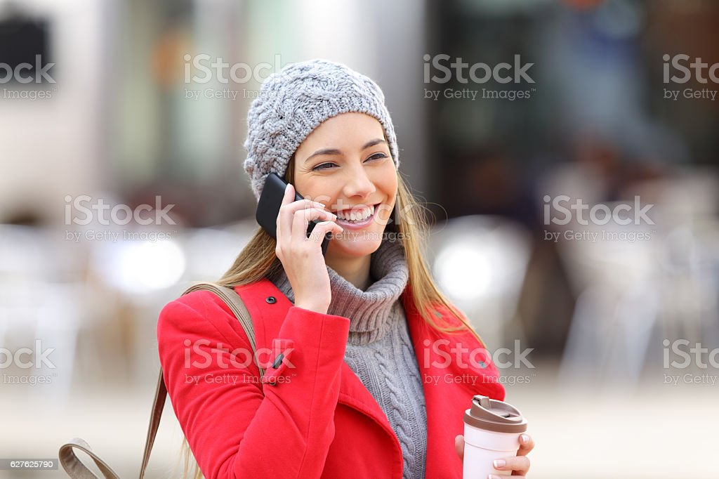 Woman calling on the mobile phone in winter stock photo