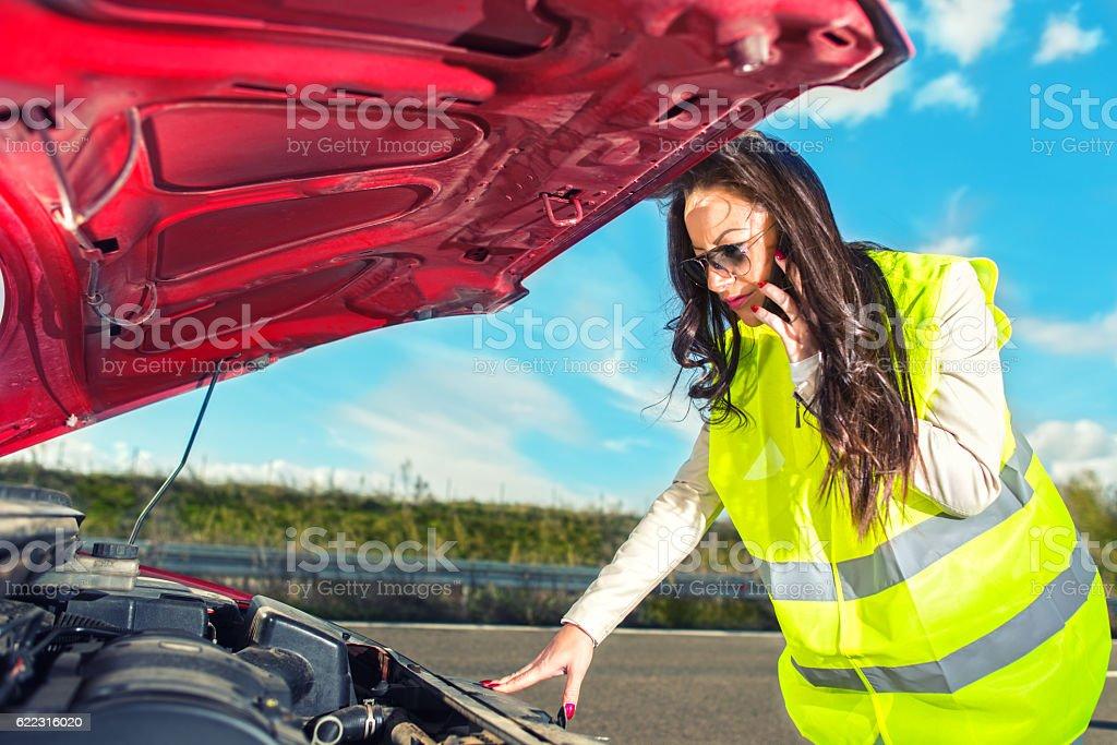 Woman calling the roadside service stock photo