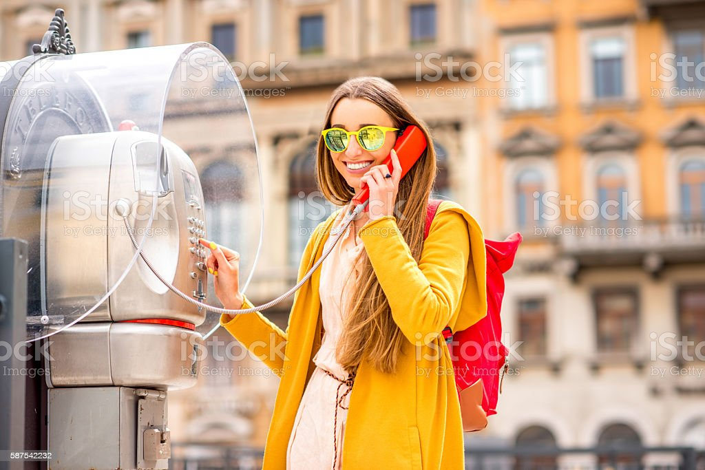 Woman calling with call box stock photo