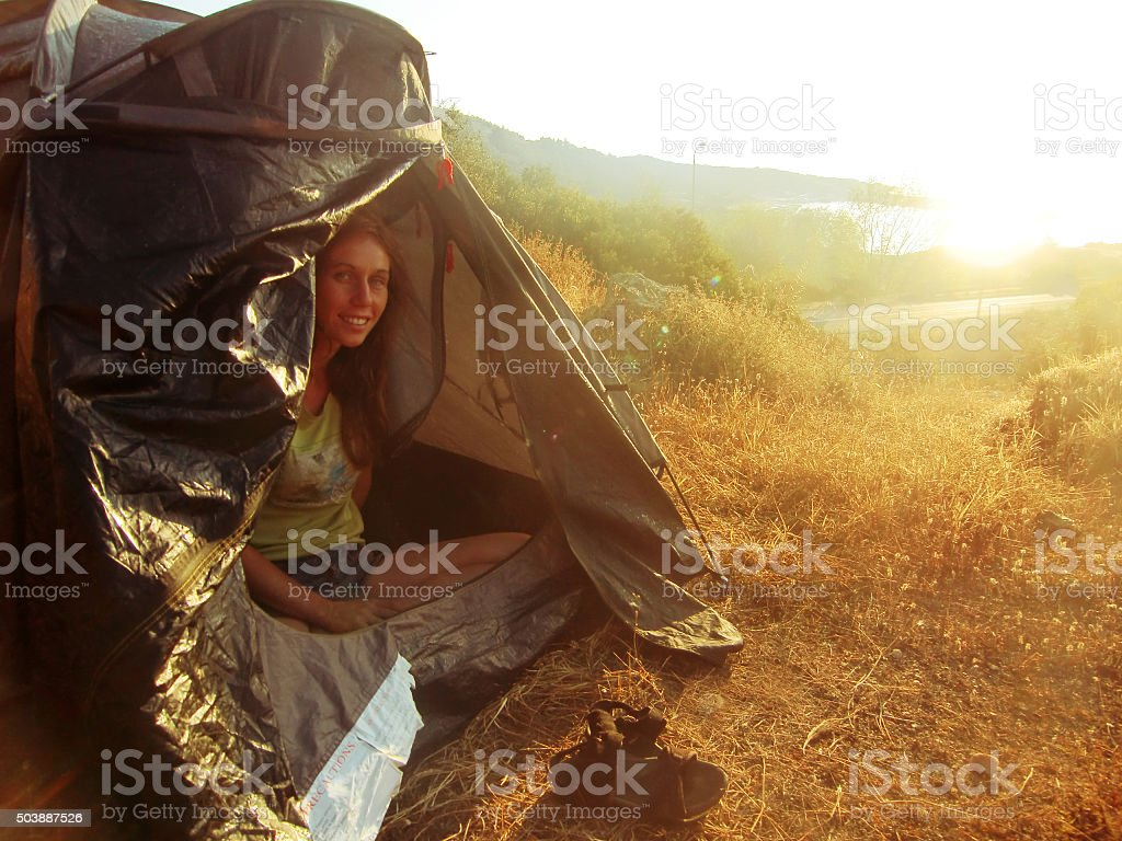 Woman Camping in the Nature stock photo
