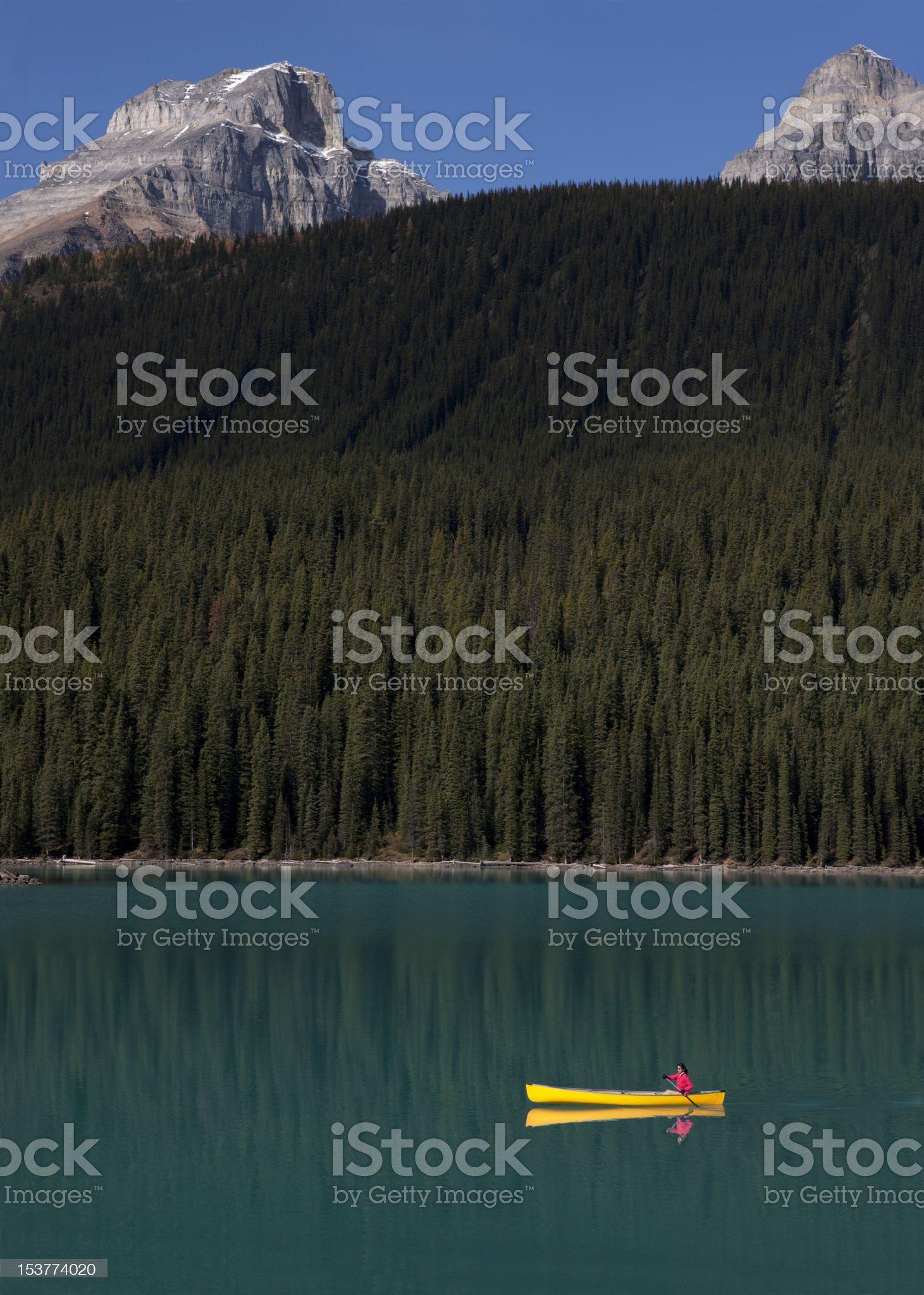 Woman Canoeing on Lake Moraine, Alberta, Canada royalty-free stock photo