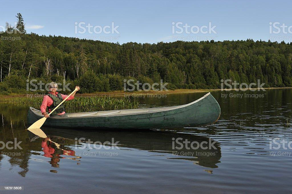 Woman canoeing on lake. royalty-free stock photo