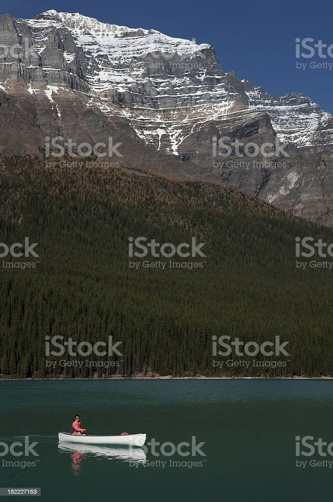 Woman Canoeing on Moraine Lake , Alberta, Canada royalty-free stock photo