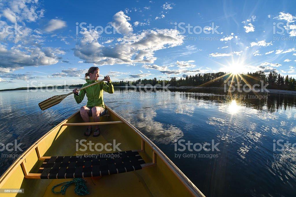 Woman Canoeing stock photo
