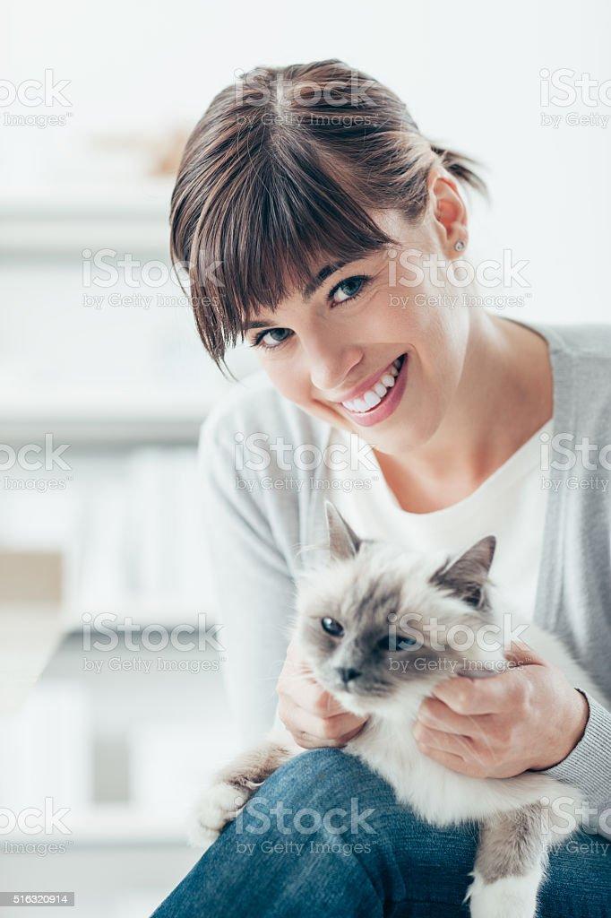 Woman caressing her birman cat stock photo