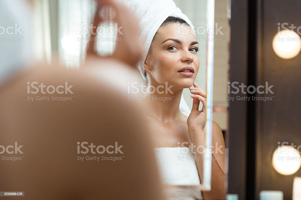 Woman caring about her skin stock photo